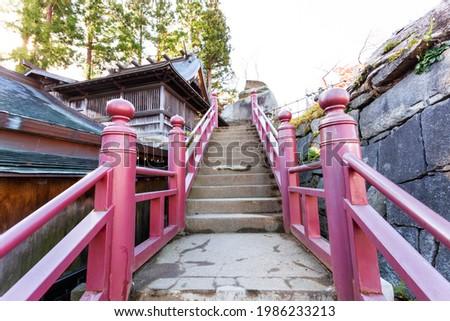 Red stairway of Sakurayama Shrine, located near Iwate park in Morioka city, Tohoku, Japan. Stock photo ©