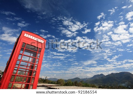 .red telephone box on hill-outdoor.