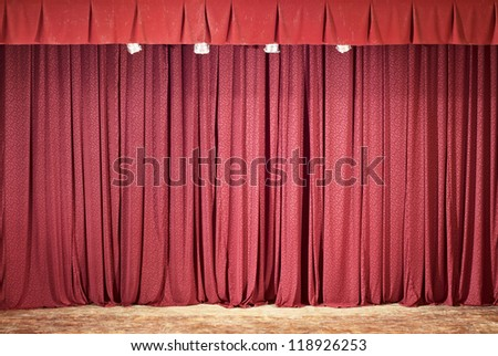 Red theater curtain, lights and shadows