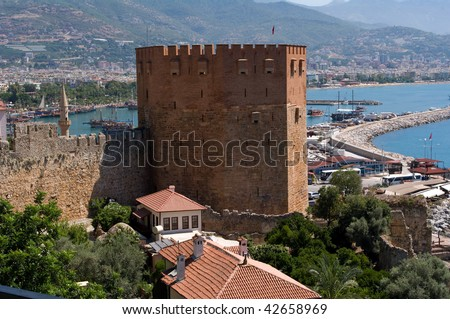 """Red Tower"" and ruins of Ottoman fortress in Alanya (Turkey)"