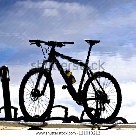 Reflection Of A Mountain Bike Standing At The Water Front ...
