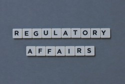 ' Regulatory Affairs ' word made of square letter word on grey background.