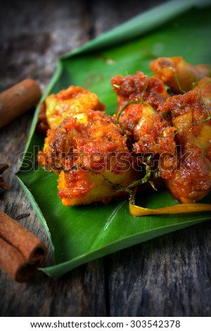 Popular Indonesia Eid Al-Fitr Feast - stock-photo--rendang-is-served-in-malaysia-singapore-brunei-indonesia-and-southern-philippines-rendang-is-303542378  Trends_993859 .jpg
