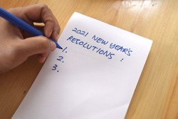 2021 resolutions, goals plans in life, business, close up of man writing and preparing for new year 2021