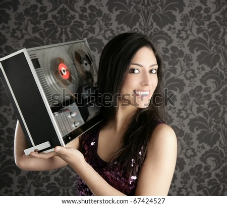 Retro open reel tape recorder beautiful brunette Dj hearing music gray wallpaper
