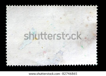 reverse side of post stamp on black background