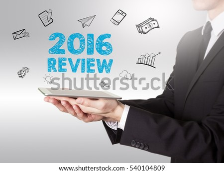 2016 Review concept, young man holding a tablet computer #540104809