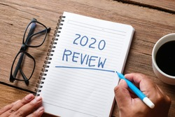 2020 Review; last year review in life; flat lay business concept. Writing and preparing for new year 2021 resolutions