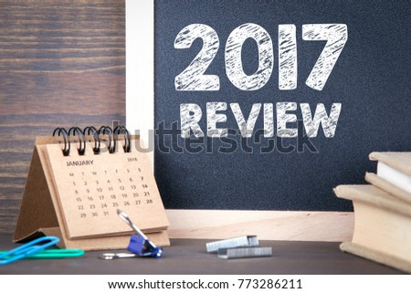 2017 review. paper calendar and chalkboard on a wooden table #773286211