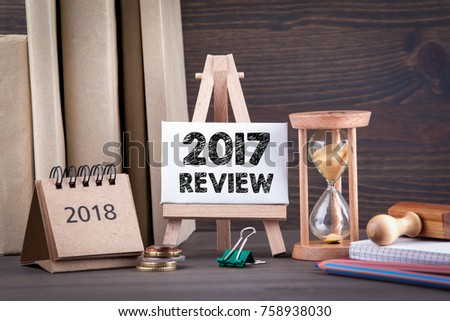 2017 review. Sandglass, hourglass or egg timer on wooden table showing the last second or last minute or time out #758938030