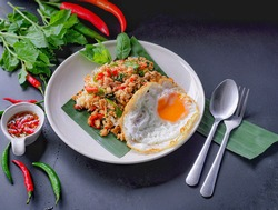 rice topped with stir-fried mince pork and basil with fried egg , Thai  population  Street food