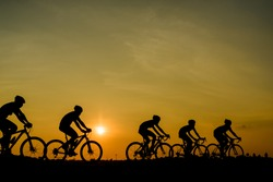 ride bicycle on sunset background