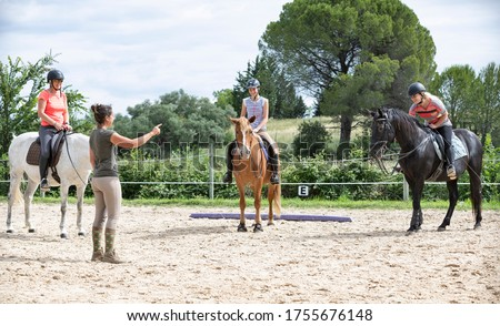 riding girl are training her horse in equestrian center Stock photo ©