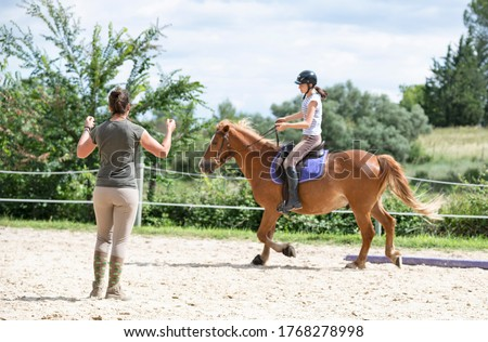 riding girl are training her horse in equestrian center Сток-фото ©