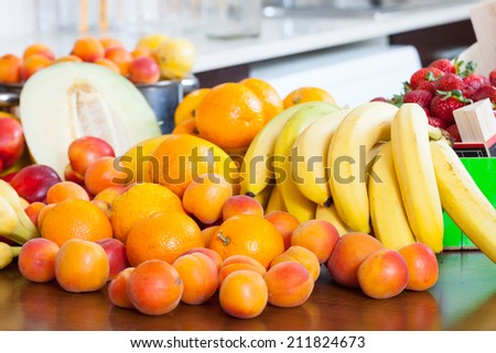 ripe fruits on kitchen table at home