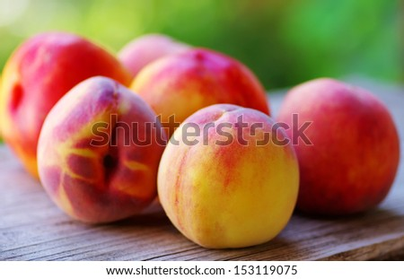 Ripe peaches on wooden table