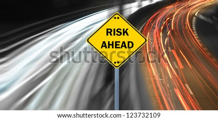 """""""RISK AHEAD"""" sign against highway trails"""