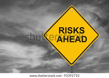"""""""Risks Ahead"""" sign on a stormy sky background"""