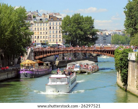 river Seine,  bridge Pont au Double,  walking ships, paris