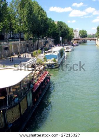 river Seine,  bridge Pont au Double,  walking ships, paris