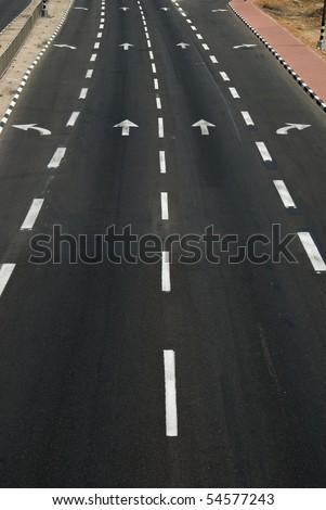 road arrow direction on asphalt