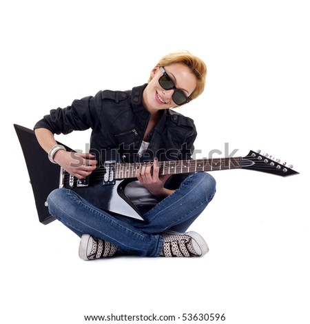 rock girl playing an electric guitar sitting down