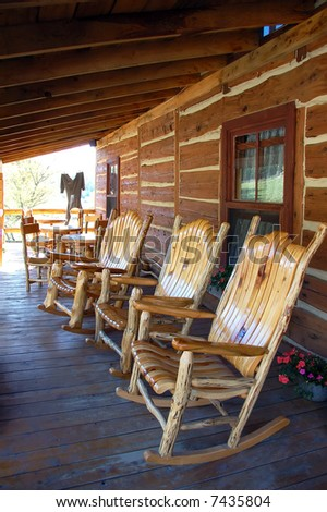 3 rocking-chair on the front porch of a traditional old farm