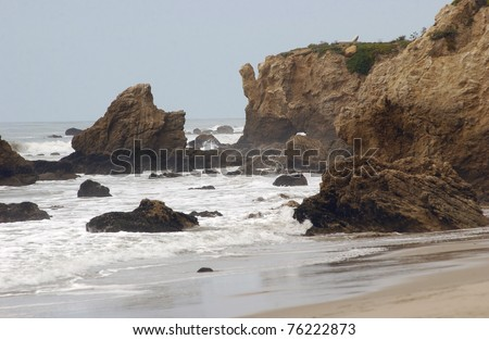 Rocks along Leo Carillo Beach in southern California with waves crashing along the beach