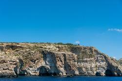 Rocky coast of Malta from the sea. Dingli Cliffs. Cliffs texture