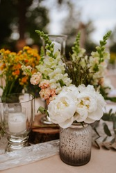 Romantically decorated table for a special event. Floral decoration for celebration