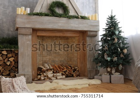 room with fireplace christmas tree and firewood #755311714