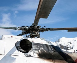 Rotor, base of the blades and the turbine nozzle did not exist in the helicopter rotor against the blue sky in the mountains. The design of the central part of the attachment of the rotor blades