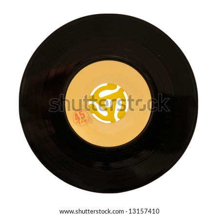 45rpm vinyl record with adapter in center. Grungy label with scratches at 100%.