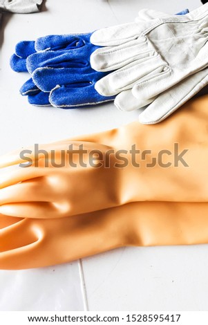 Rubber gloves and safety gloves