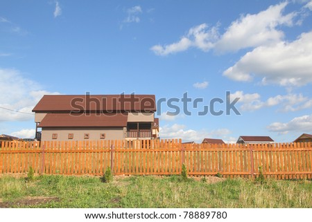 rural house behind a fence