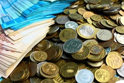 Russian money bills, coins. The face value of banknotes is 5000 five thousand, 2000 thousand rubles, and coins ten, five, two rubles and a penny.