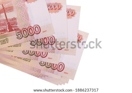 5000 russian rubles bills lies in small bunch or pack isolated on white. Mockup with copy space. Business and currency exchange concept Stock foto ©