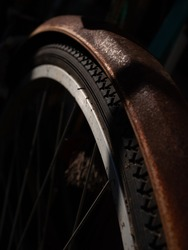 Rusted old bicycle. Black background.