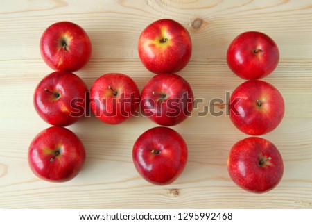 Rustic hi word. Apples word hi. The word hi is made up of red apples on a wooden table #1295992468
