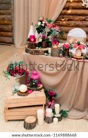 Rustic style wedding decor. for newlyweds. Flowers arrangements on a sawed wood. Timber background.  #1169888668