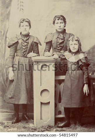 1800s Antique vintage portrait photo of three young girls dressed in Victorian style clothing