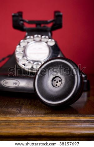1940s bakelite telephone, with the earpiece in focus.