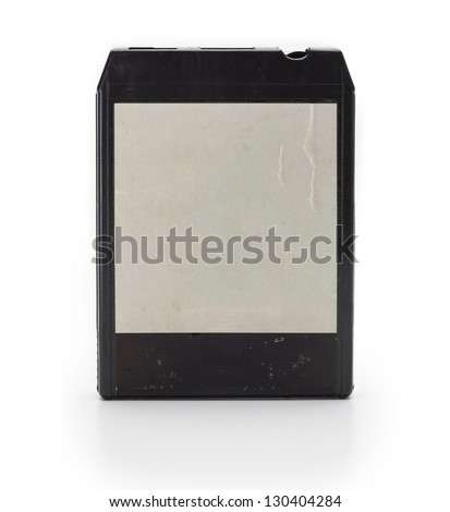 1970s eight-track cartridge or eight-track tape with old blank label, isolated on white with slight reflection.