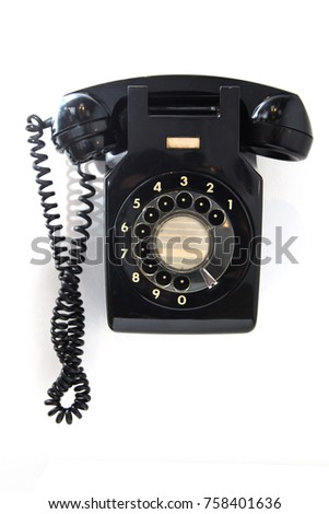 1960's England Face Standard ITT wall telephone (black) was a rotary-dial type and commonly used at offices attached to the wall.