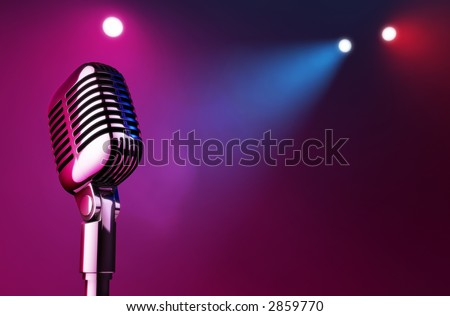 50s mic over stage light background. - stock photo