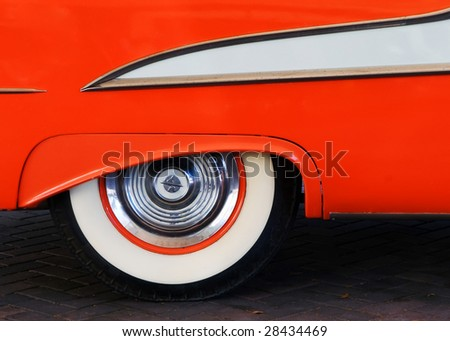 1950's orange car and tire