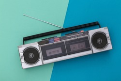 80s Retro Outdated Portable Stereo Radio Cassette Recorder on Blue Background. Top view
