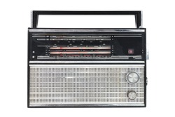 1960s retro radio isolated over white.