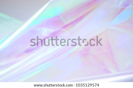 80s, 90s background. Holographic abstraction - TRENDY colorful texture in pastel colors. Very beautiful iridescent texture. Holography foil. Hologram background of wrinkled abstract foil texture  - Shutterstock ID 1035129574
