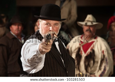 1800s style man in old west theme points his gun